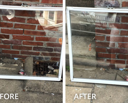 A broken commercial window is fixed.