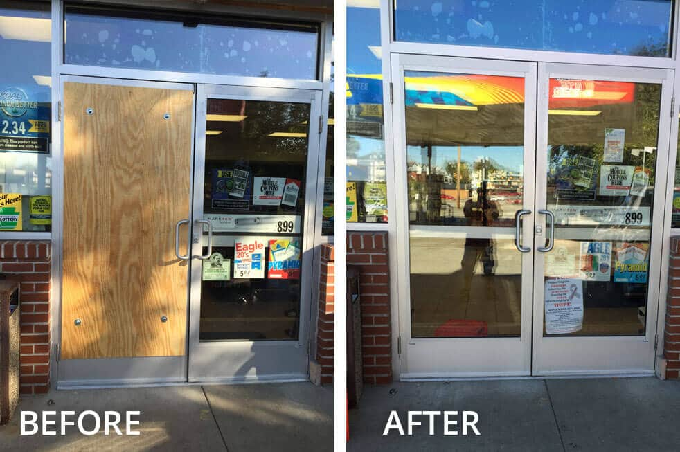 A new glass panel is installed on a gas station door.